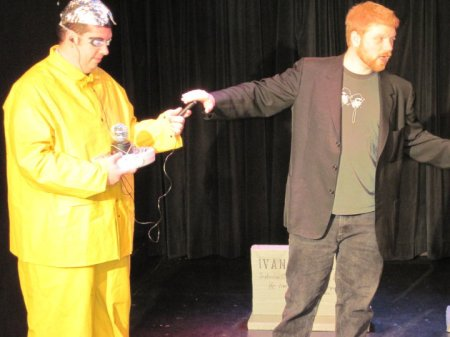 Nerd in yellow raincoat talks to the dead
